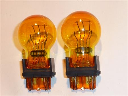 BRAND NEW 2 PIECE PAIR OF T3157NA 3157 AMBER BULBS 3157